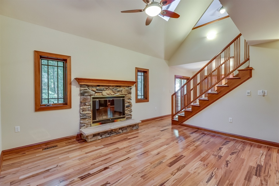 Real Estate Photography - 181 Proctors Purchase Rd, Hartly, DE, 19953 - Great room w/wood burning fireplace & skylights