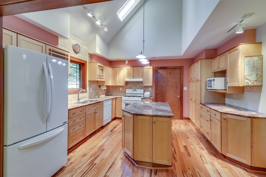 Real Estate Photography - 181 Proctors Purchase Rd, Hartly, DE, 19953 - Gorgeous kitchen w/hardwood floor & skylights
