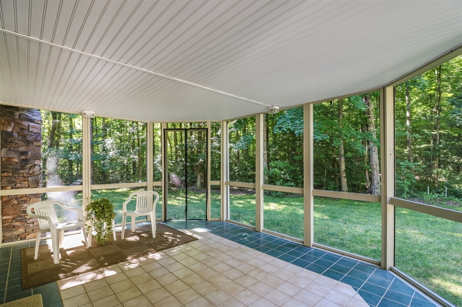 Real Estate Photography - 181 Proctors Purchase Rd, Hartly, DE, 19953 - Screened porch surrounded by nature
