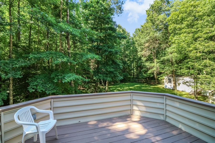 Real Estate Photography - 181 Proctors Purchase Rd, Hartly, DE, 19953 - 2nd floor deck overlooking the backyard
