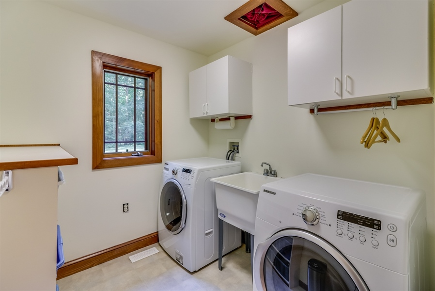 Real Estate Photography - 181 Proctors Purchase Rd, Hartly, DE, 19953 - Laundry room includes the laundry chute