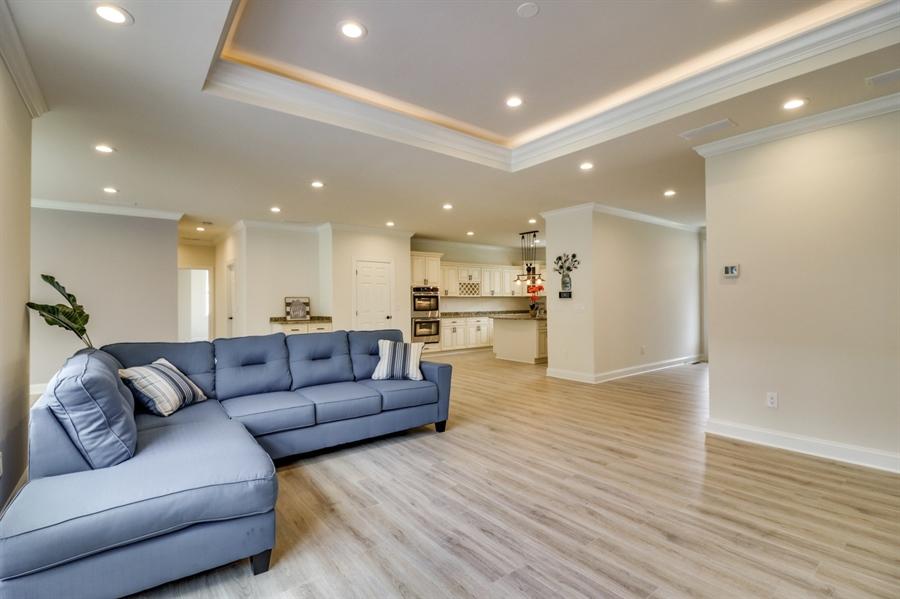 Real Estate Photography - 28459 Cedar Ridge Dr, Millsboro, DE, 19966 - Worry-Free, Waterproof Laminate Floor & LED Lights