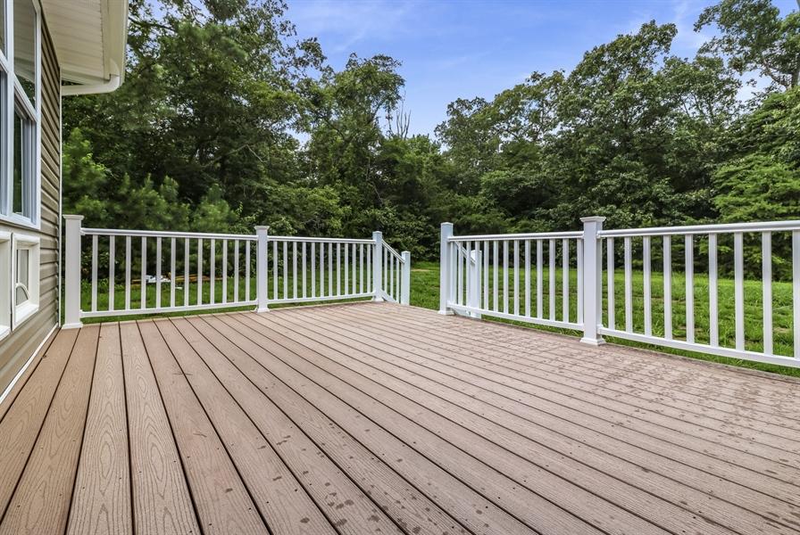 Real Estate Photography - 28459 Cedar Ridge Dr, Millsboro, DE, 19966 - Large Composite Deck Overlooking the Backyard