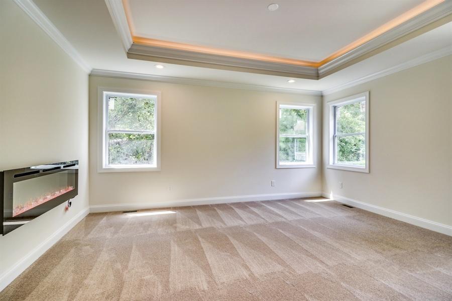 Real Estate Photography - 28459 Cedar Ridge Dr, Millsboro, DE, 19966 - Master Bedroom w/Cozy Fireplace & Tray Ceiling
