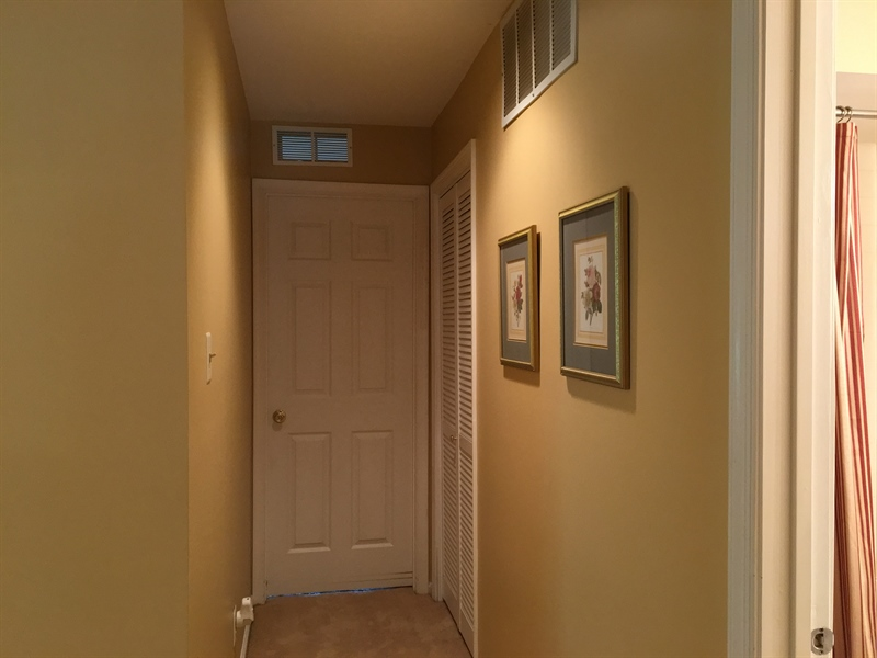 Real Estate Photography - 1400 Braken Ave, Wilmington, DE, 19808 - Hallway with main level laundry