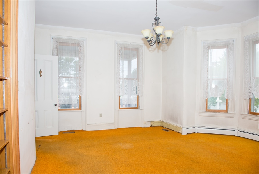 Real Estate Photography - 215 N Cass St, Middletown, DE, 19709 - 14' X 17' dining room with bay window