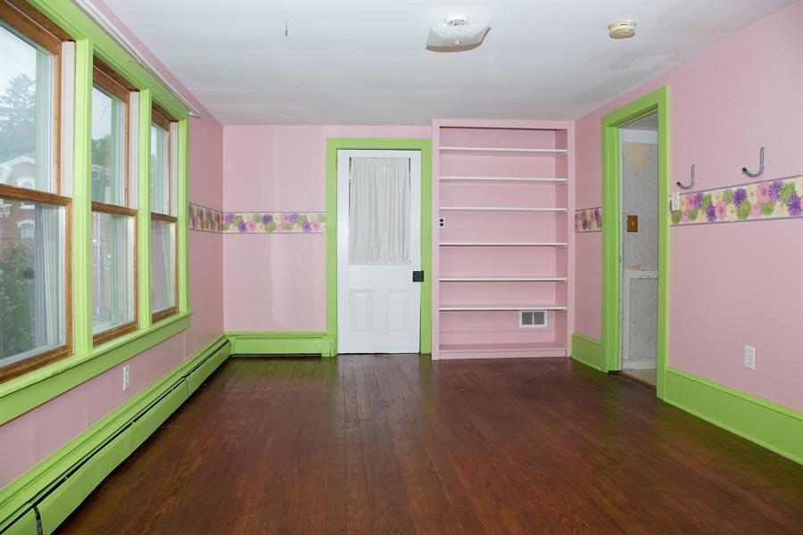 Real Estate Photography - 215 N Cass St, Middletown, DE, 19709 - 11' X 16' bedroom w/hardwood floors