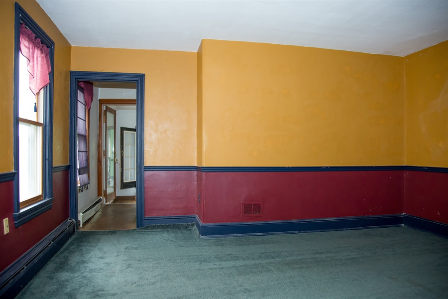 Real Estate Photography - 215 N Cass St, Middletown, DE, 19709 - 9' X 13' library/playroom