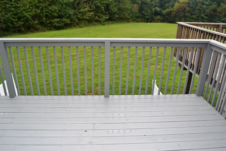 Real Estate Photography - 22 John Hall Dr, Ocean View, DE, 19970 - Newly Painted Deck