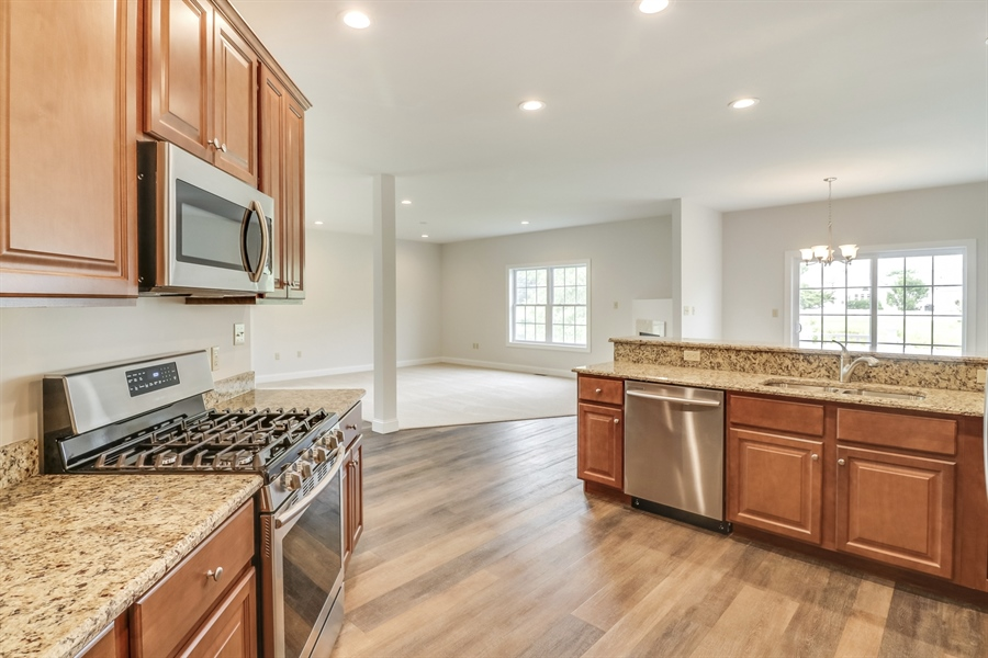 Real Estate Photography - 146 Laks Ct, Smyrna, DE, 19977 - Kitchen opens to the great room