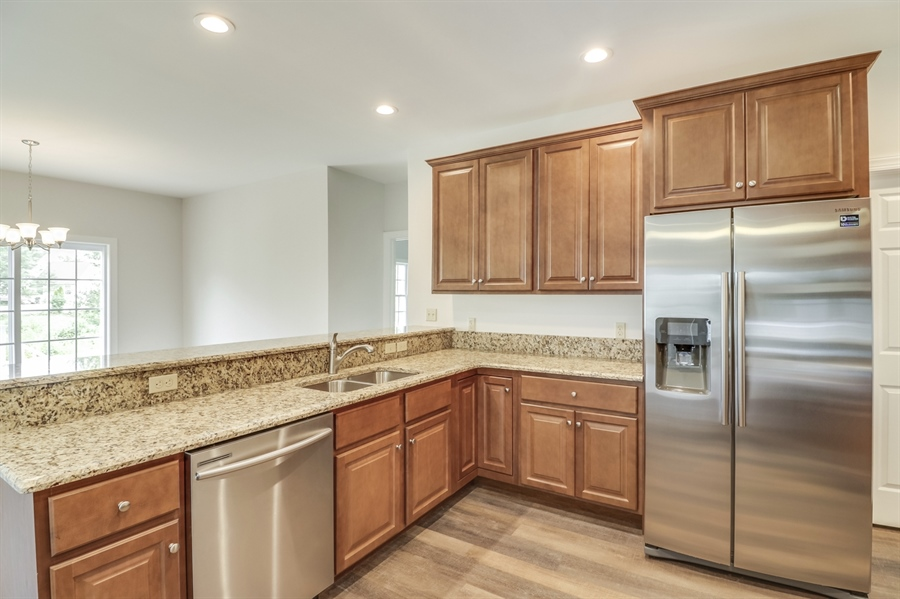 Real Estate Photography - 146 Laks Ct, Smyrna, DE, 19977 - Granite countertops, stainless steel appliances