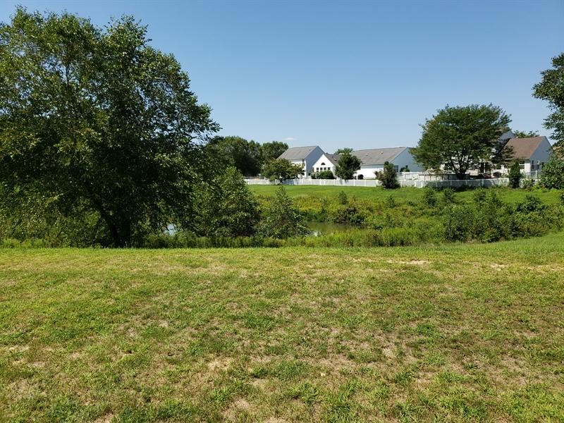 Real Estate Photography - 146 Laks Ct, Smyrna, DE, 19977 - Gorgeous back yard; home backs up to a pond
