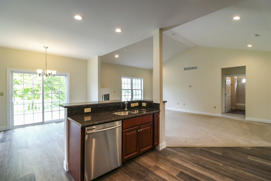Real Estate Photography - 164 Laks Ct, Smyrna, DE, 19977 - Kitchen opens to the breakfast nook & great room