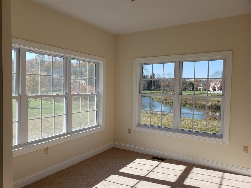Real Estate Photography - 164 Laks Ct, Smyrna, DE, 19977 - Inviting sunroom w/pond view