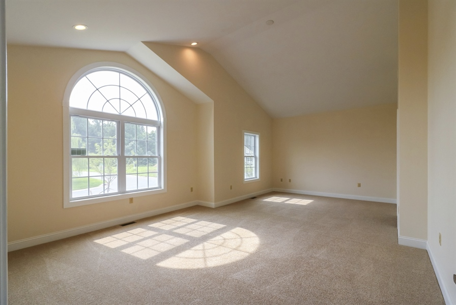 Real Estate Photography - 164 Laks Ct, Smyrna, DE, 19977 - Main bedroom w/a sitting room & cathedral ceiling