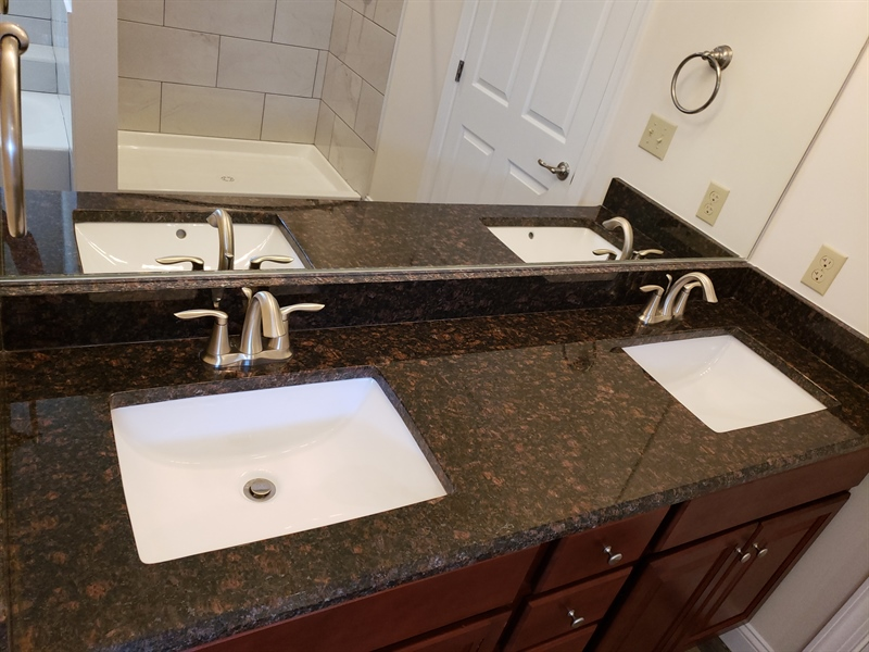 Real Estate Photography - 164 Laks Ct, Smyrna, DE, 19977 - Double vanity with granite countertop