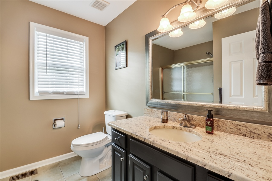 Real Estate Photography - 142 Bromley Dr, Wilmington, DE, 19808 - Hall Bath with Granite Top Vanity and Tile Floor