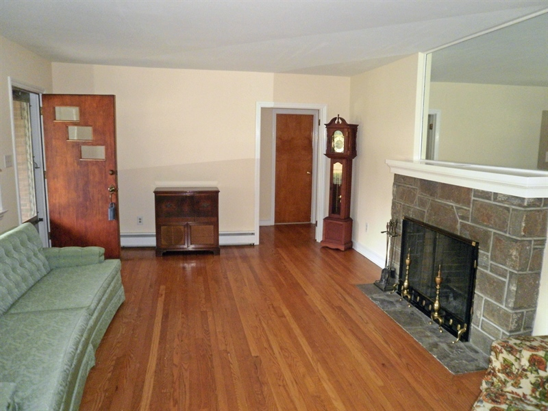 Real Estate Photography - 51 Oaknoll Rd, Wilmington, DE, 19808 - Hardwood floors and fireplace in the living room