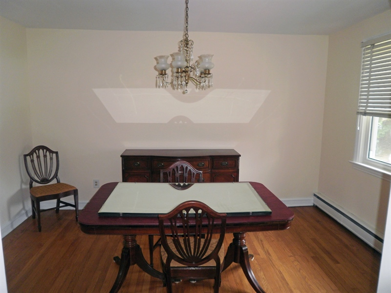 Real Estate Photography - 51 Oaknoll Rd, Wilmington, DE, 19808 - Formal dining room with hardwood floors