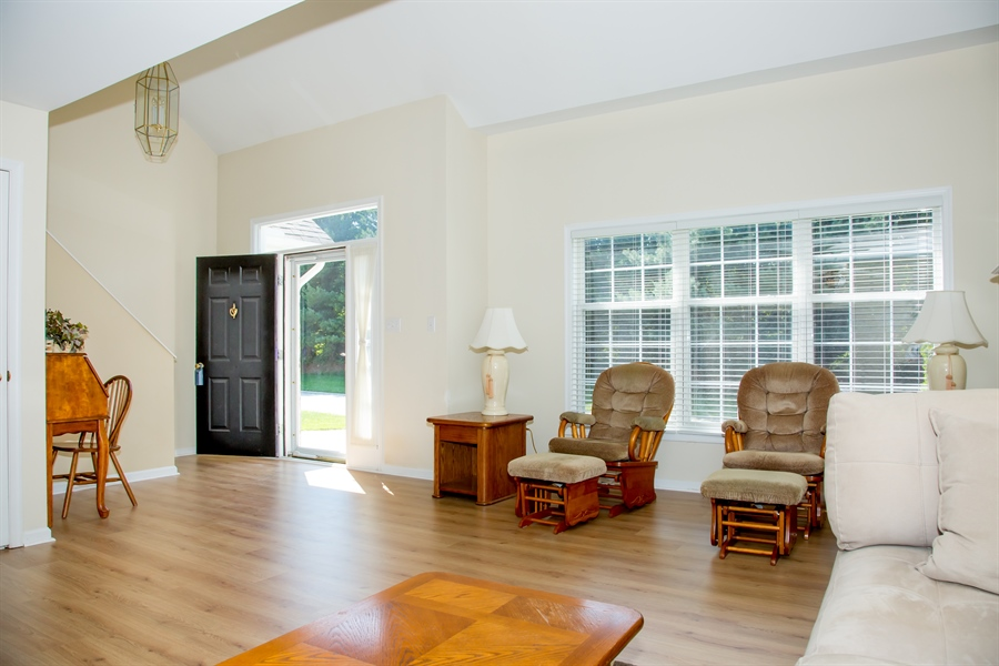 Real Estate Photography - 30 Longbow Ter, Hockessin, DE, 19707 - Gr. Rm. (cont) w/finished flooring, gas fireplace