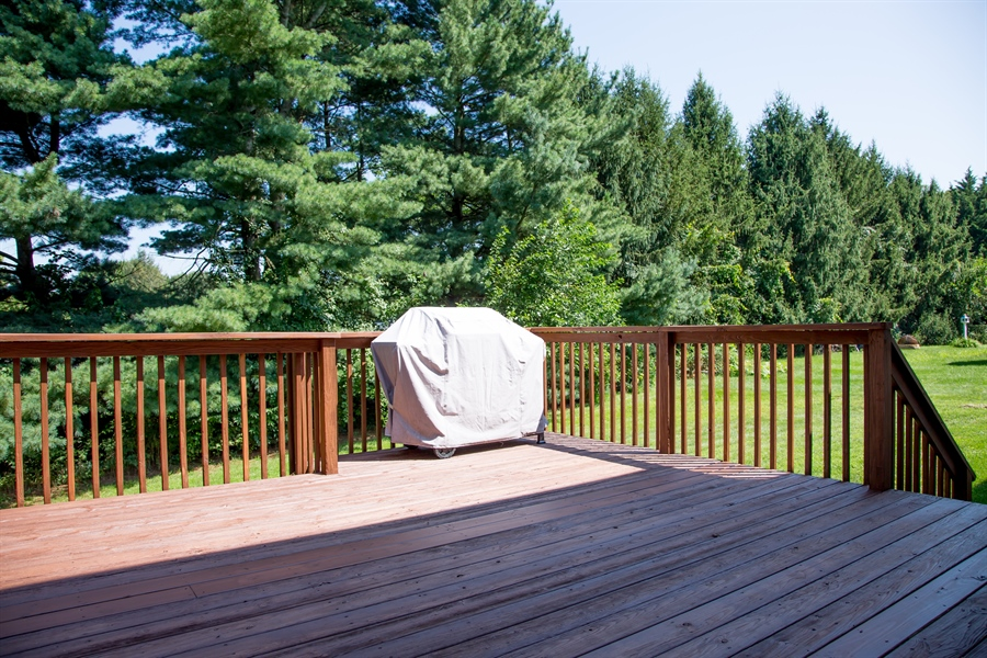 Real Estate Photography - 30 Longbow Ter, Hockessin, DE, 19707 - Deck (cont.) w/ stairs to rear yard