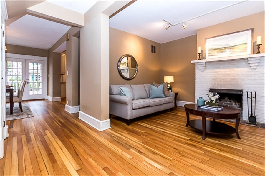 Real Estate Photography - 2101 N Grant Ave, Wilmington, DE, 19806 - Open plan with fireplace in living room