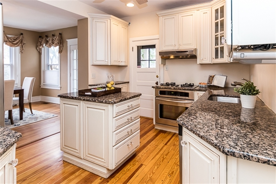 Real Estate Photography - 2101 N Grant Ave, Wilmington, DE, 19806 - Granite countertops + stainless steel appliances