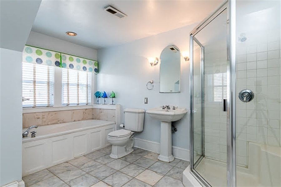 Real Estate Photography - 2101 N Grant Ave, Wilmington, DE, 19806 - Owner's Bathroom with soaking tub/shower