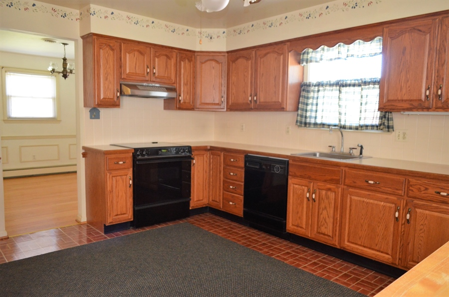 Real Estate Photography - 103 Admiral Dr, Wilmington, DE, 19804 - Kitchen into Dining Room