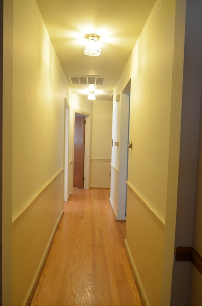 Real Estate Photography - 103 Admiral Dr, Wilmington, DE, 19804 - Hallway leading to Bedrooms and Full Bath