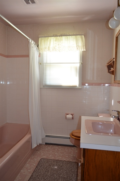 Real Estate Photography - 103 Admiral Dr, Wilmington, DE, 19804 - Main Level Bathroom w Laundry Chute