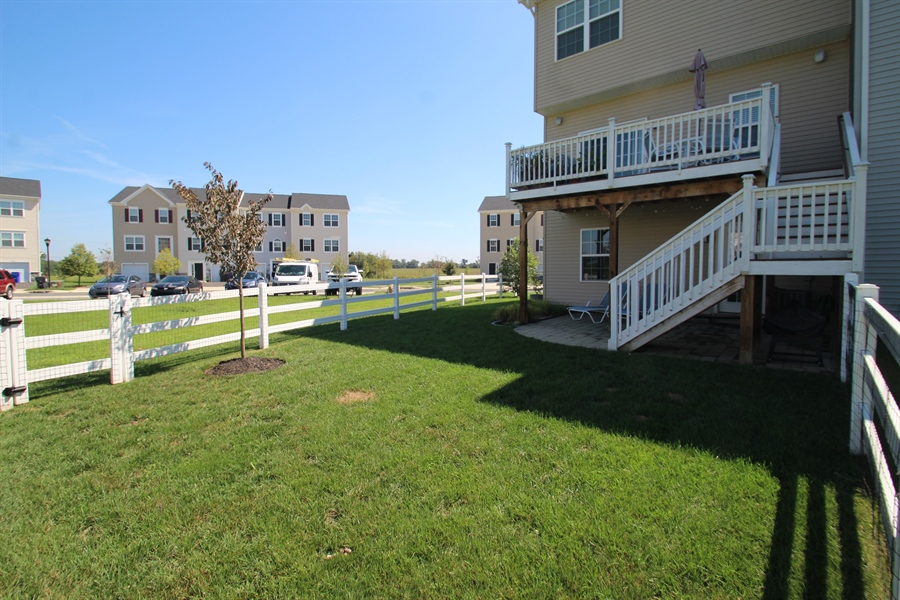 Real Estate Photography - 960 Lissicasey Loop, Middletown, DE, 19709 - Rear View and Deck