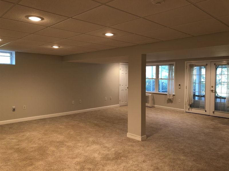 Real Estate Photography - 43 Pierson Dr, Hockessin, DE, 19707 - Huge Finished Basement rec room leads to...