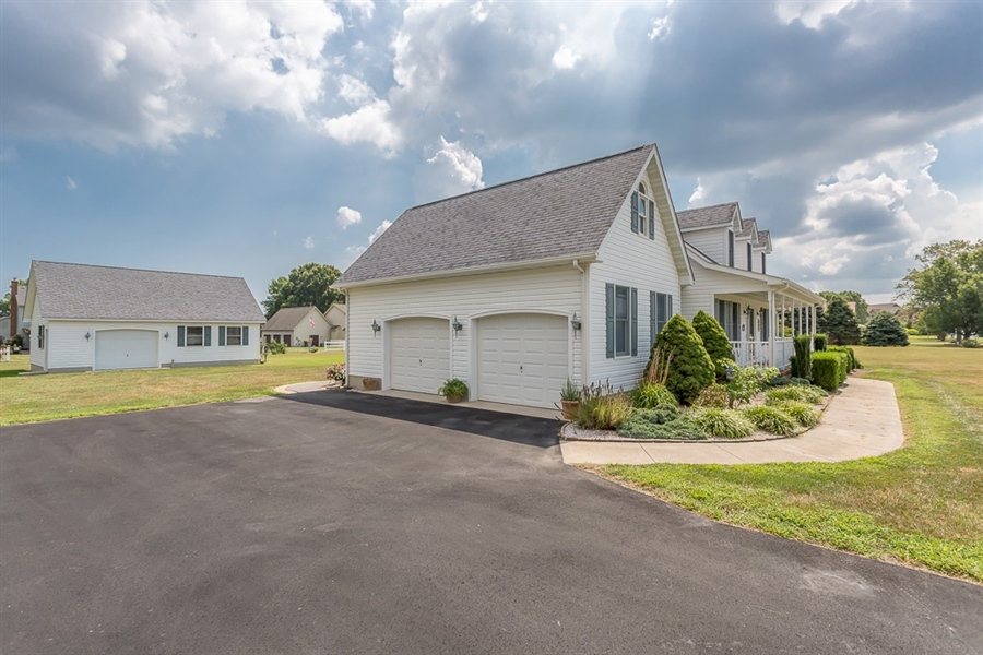 Real Estate Photography - 316 Pond Rd, Millsboro, DE, 19966 - Two car garage with additional detached shop.