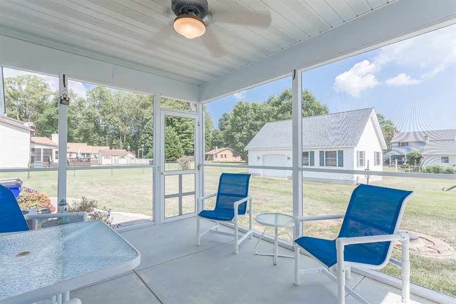 Real Estate Photography - 316 Pond Rd, Millsboro, DE, 19966 - Wonderful screened in porch.