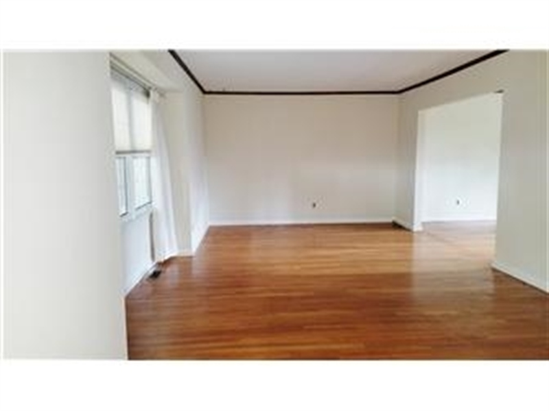 Real Estate Photography - 4012 Greenmount Dr, Wilmington, DE, 19810 - Spacious great/living room with hardwood floors