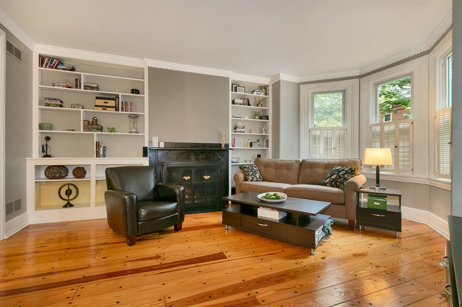 Real Estate Photography - 1003 Trenton Pl, Wilmington, DE, 19801 - Spacious Living Room w/ Fireplace and Built-Ins