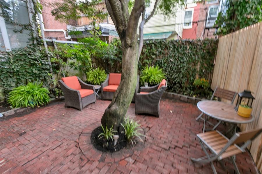 Real Estate Photography - 1003 Trenton Pl, Wilmington, DE, 19801 - Quaint Back Yard with Pretty Foliage