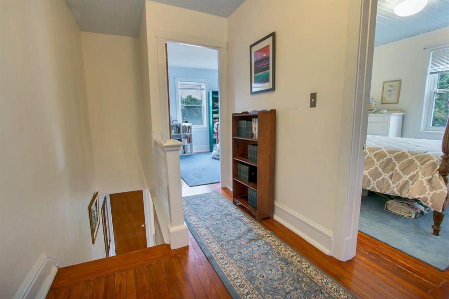 Real Estate Photography - 433 S Bancroft Pkwy, Wilmington, DE, 19805 - Upstairs Hallway W/ Gleaming Hardwood Floors