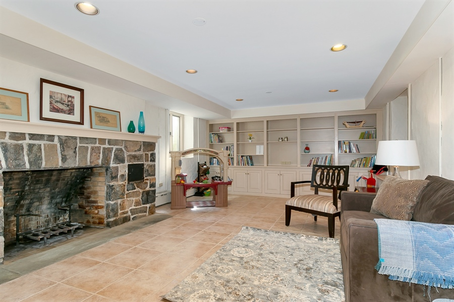 Real Estate Photography - 915 Westover Rd, Wilmington, DE, 19807 - Lower Level Family Room with Fireplace