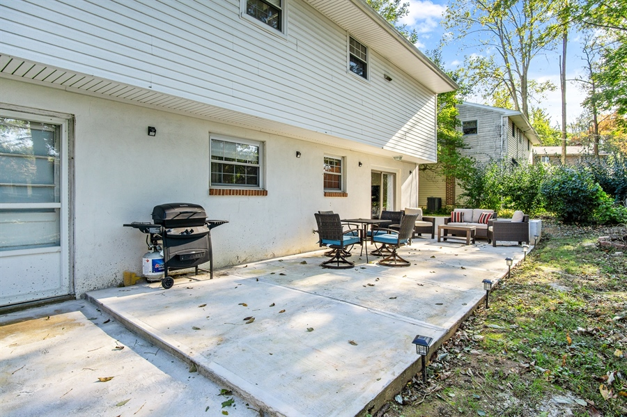 Real Estate Photography - 2604 Bittersweet Dr, Wilmington, DE, 19810 - HUGE patio in tree lined yard