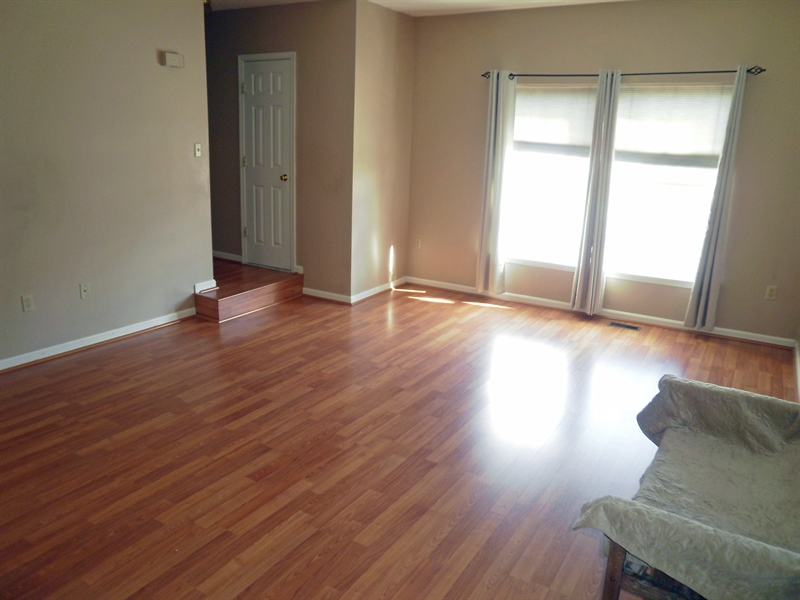 Real Estate Photography - 42 Highland Cir, Newark, DE, 19713 - Laminate flooring in the living/dining room