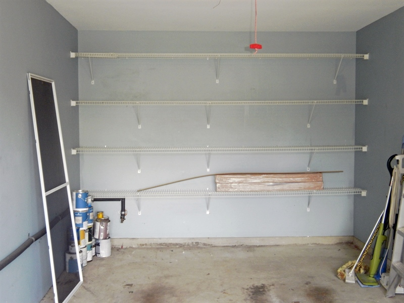 Real Estate Photography - 42 Highland Cir, Newark, DE, 19713 - Extra shelving in the attached garage w/opener