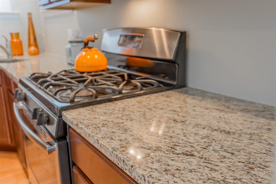 Real Estate Photography - 37684 Ulster Drive #1, 1, Rehoboth Beach, DE, 19971 - Tasteful Granite & Gas Cooking