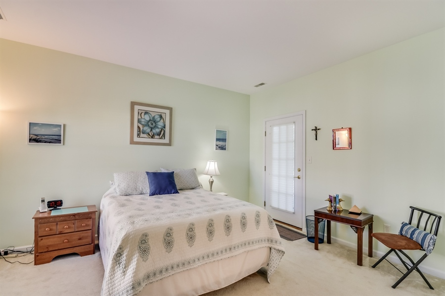 Real Estate Photography - 104 Dawn Ct, Middletown, DE, 19709 - Owners Bedroom with access to screened porch