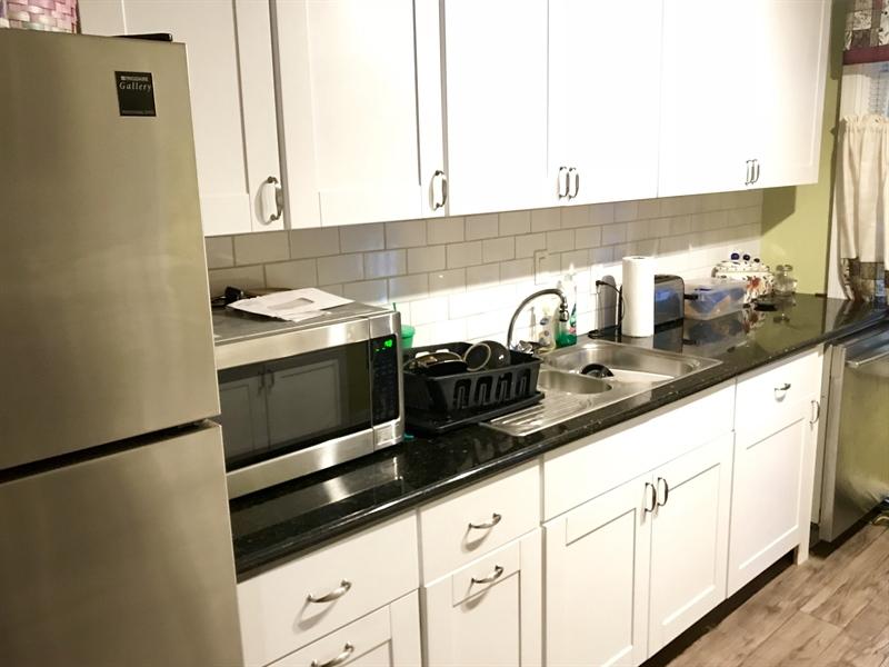 Real Estate Photography - 108 E 14th St, Wilmington, DE, 19801 - White cabinets w/granite countertops