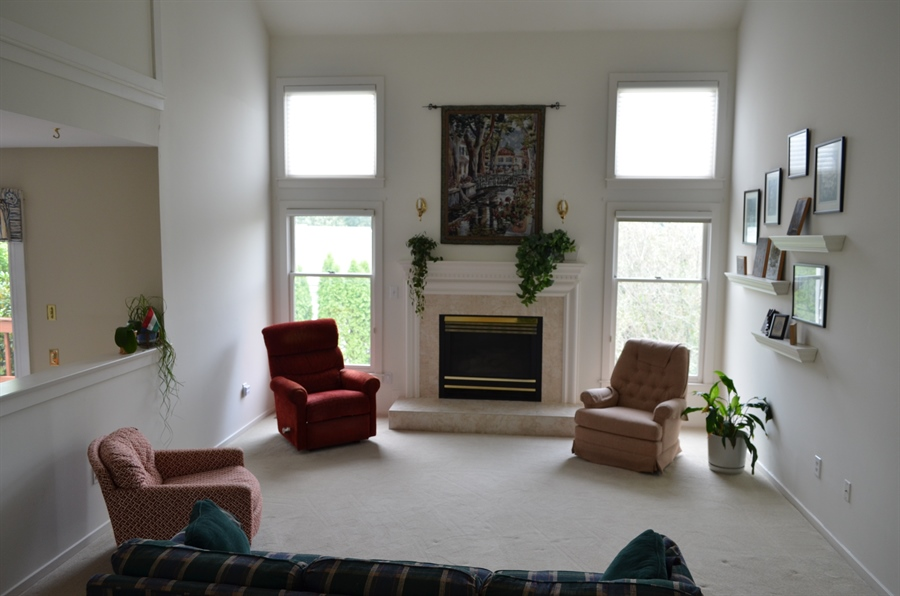 Real Estate Photography - 66 Springer Ct, Hockessin, DE, 19707 - Living Room w Gas Fireplace & Skylights