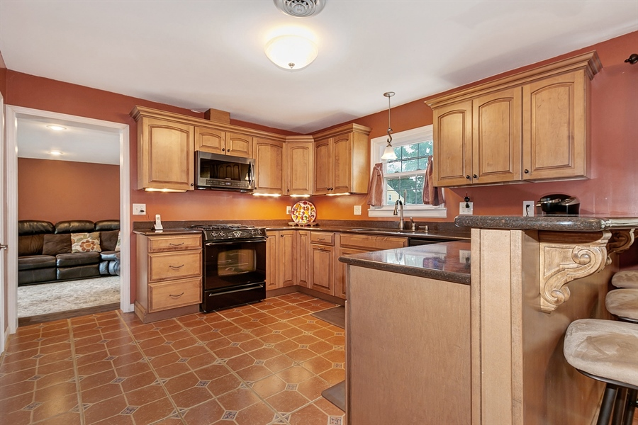 Real Estate Photography - 409 Rosewood Dr, Newark, DE, 19713 - Stunning Kitchen with Kraftmaid maple cabinets
