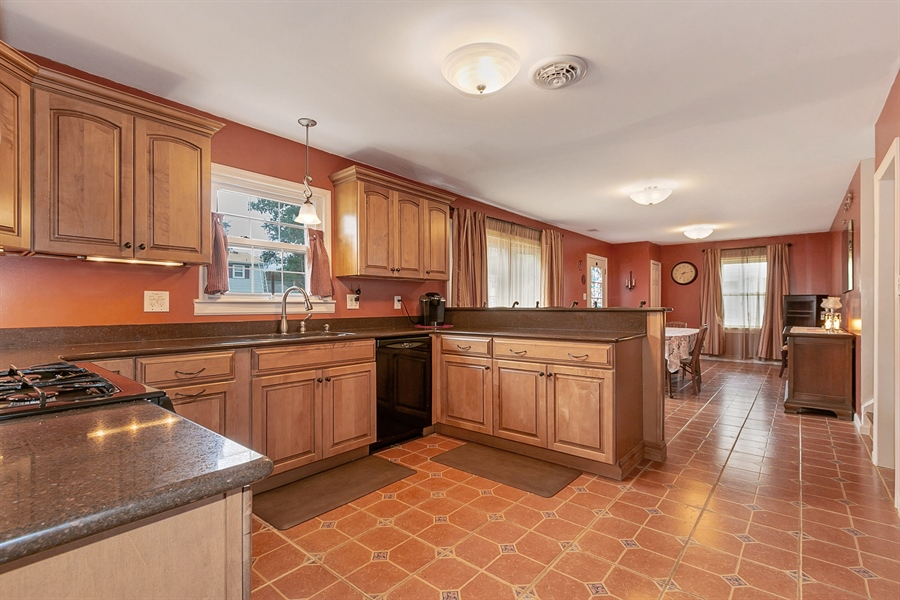 Real Estate Photography - 409 Rosewood Dr, Newark, DE, 19713 - 12 x 12 Kitchen, great flow to Dining Room