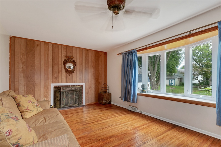 Real Estate Photography - 409 Rosewood Dr, Newark, DE, 19713 - Living Room with woodburning fireplace